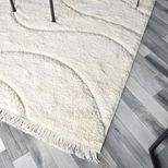 Tapis frange relief vague fond ivoire Jaya